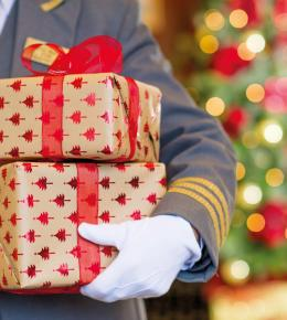 Gloved hand holding gift