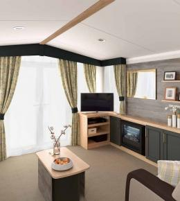 Family relaxing in a 3 Bedroom Luxury Lawnside Holiday Caravan, in North Cornwall