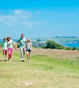 Family walking along the coastal path local to Carlyon Bay Hotel