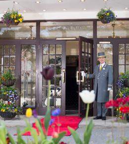 Doorman welcoming family to luxury Carlyon Bay Hotel