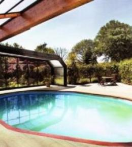 Heated pool in summer with garden views