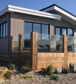 Exterior of Luxury Lodge at Trevornick Holiday Park in Cornwall.