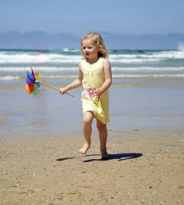 Girl playing on the beach near Hendra Holiday Park