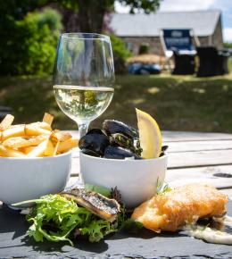 Fish Friday, a selection of Cornish mussels, mackerel & beer battered fish, accompanied with fries and wine