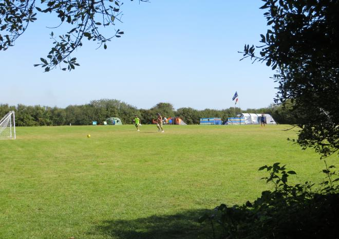Playing field at Little Trevothan with summer camping pitches