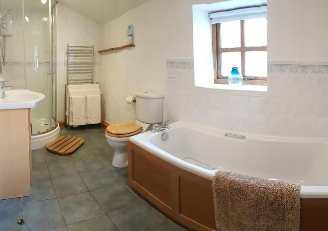 Old Basset Cottage offers lovely self-catering holiday accommodation near Porthtowan in North Cornwall - Family Bathroom with separate bath and shower