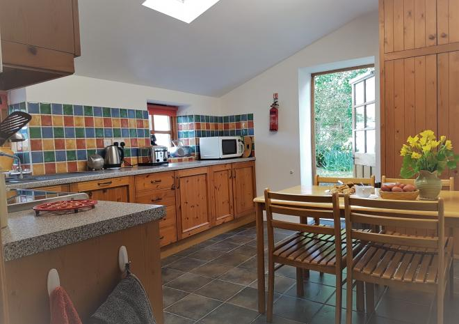 Old Basset Cottage offers lovely self-catering holiday accommodation near Porthtowan in North Cornwall - Cottage kitchen 1