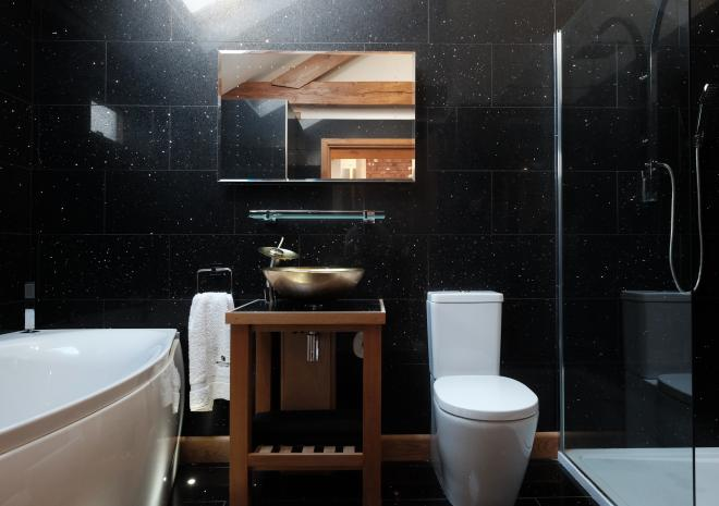 Moonshine bathroom with spa bath and walk in shower, adults only accommodation at Wooldown Holiday Cottages