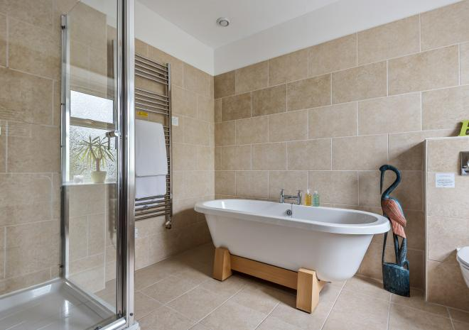 Free standing baths and large showers, perfect for travellers to relax