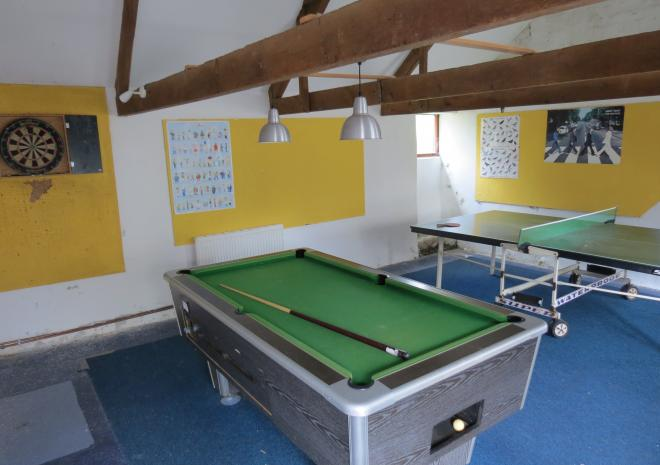 Games room with pool and table tennis tables and darts board