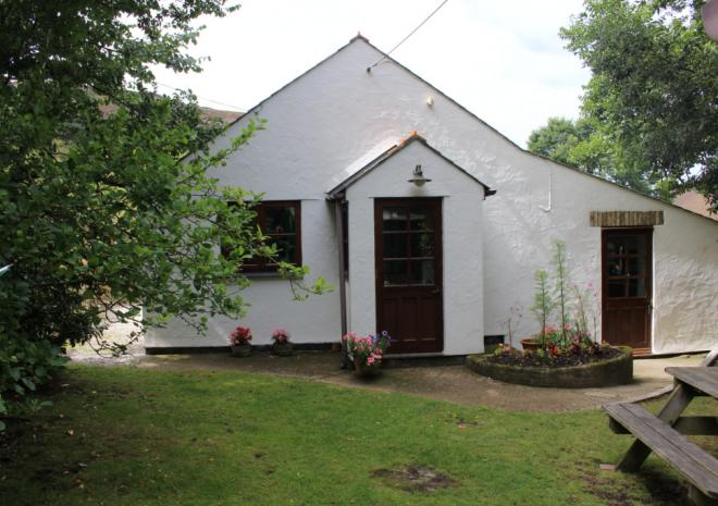 Old Basset Cottage offers lovely self-catering holiday accommodation near Porthtowan in North Cornwall - Main entrance and garden