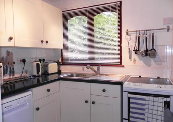 Karrek Lodge kitchen with double oven, dishwasher and fridge freezer.