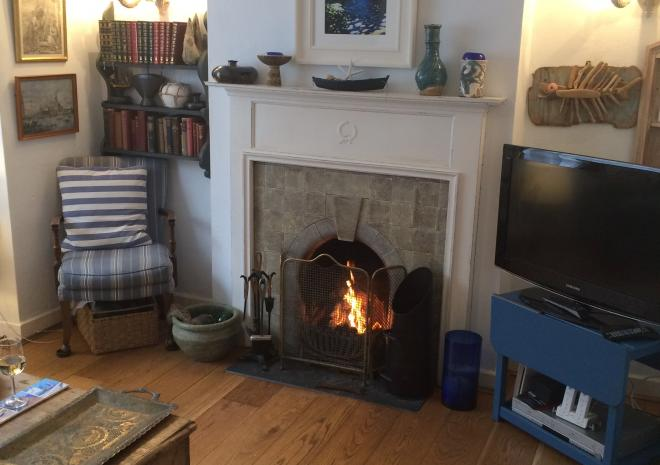 Open fire place in cosy characterful Lounge