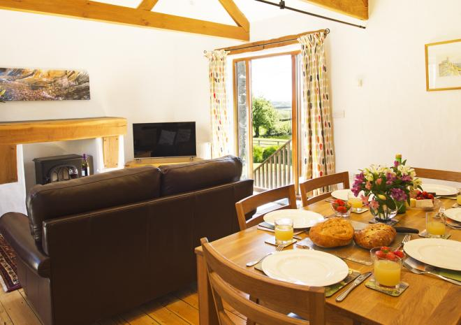 Open plan dining and sitting area with Cornish countryside views.
