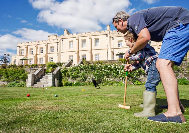 Playing croquet on the lawn at Pentillie Castle