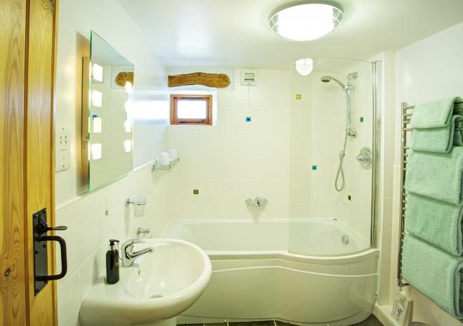 The family bathroom is right next to bedroom 2 so ideal when two couples are sharing the barn.