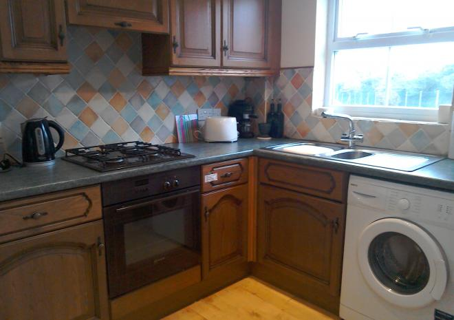Fully equipped kitchen with full size fridge,freezer,oven,hob,washing machine etc
