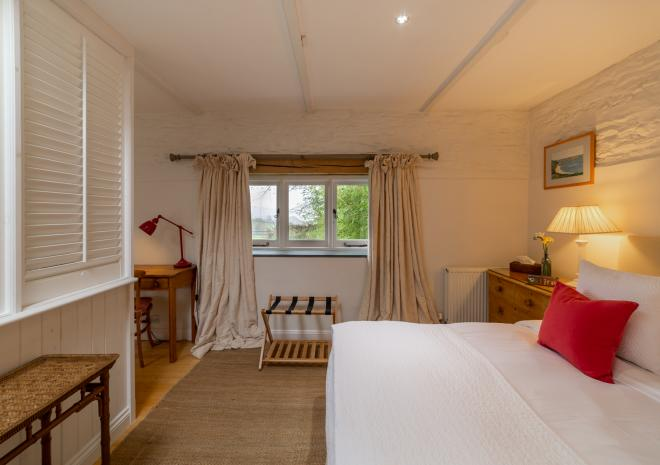 Large bedroom with ample storage and stunning country views