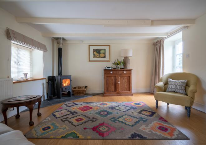 The Dairy's cosy sitting room, comfortable 4 seater sofa, easy chair