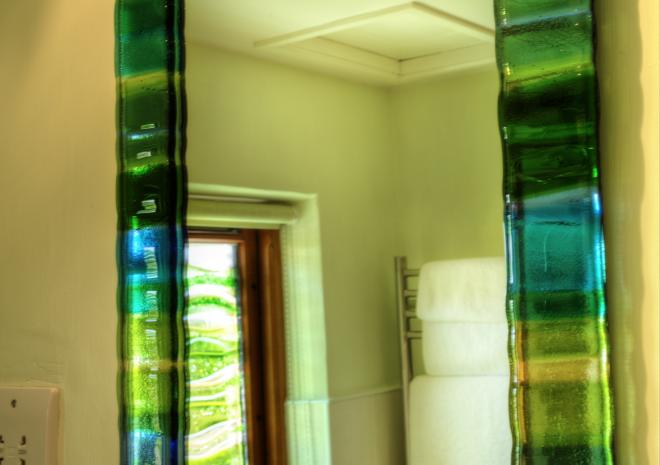 Jo Downs fused glass windows were used in both bathrooms.