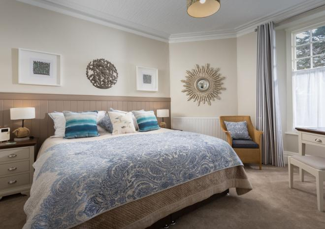 Cornish Chough's stunning bedroom with sumptuous super king bed, beautifully decorated and adorned with lovely furniture, artwork and soft furnishings.