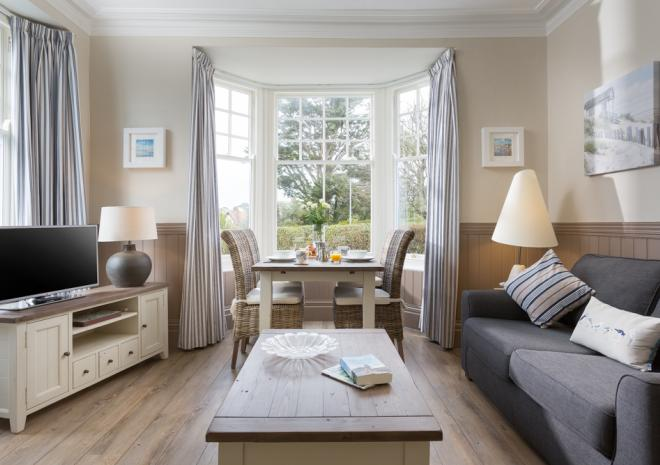 Curlew Apartment on the ground floor has the most gorgeous living space with high ceilings and beautiful Edwardian windows with sea views.