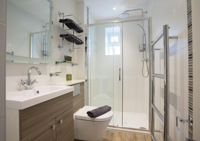 The spotlessly clean modern fully tiled shower room with walk in shower cubicle and rain and hand held shower. Towels and toiletries are provided for your stay.