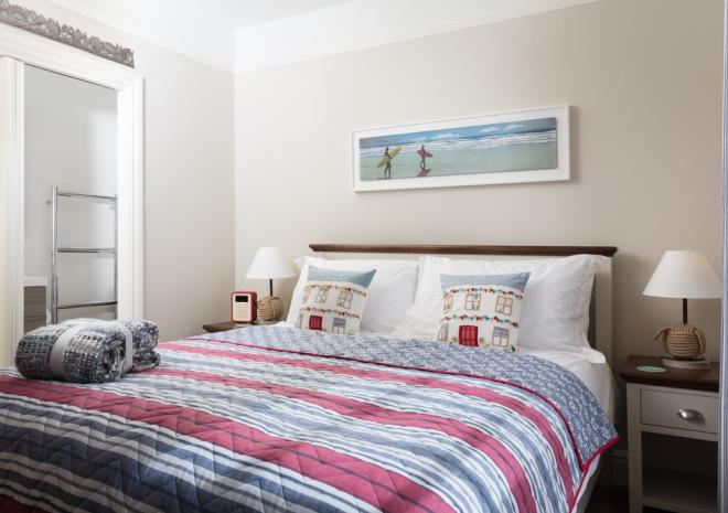 The lovely light filled bedroom of Oyster Catcher apartment which is on the first floor.