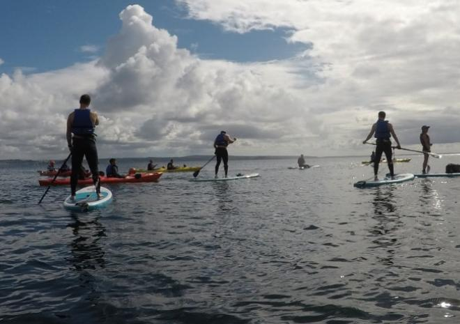 Stand Up Paddleboarding with Blue Dot Adventure