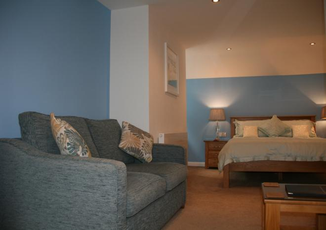 Bedroom 4 with sofa (no sea Views) at Count House Cottage, Carbis Bay, St Ives,