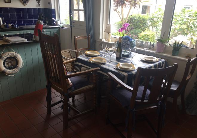 Social family dining with sea & valley views