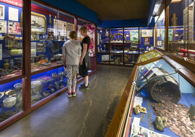 Visitors discovering ancient finds from the seabed at Charlestown's Shipwreck Treasure Museum