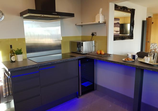 Contemporary Kitchen with extra large induction hob and wine fridge - cheers!!