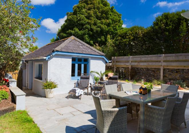 The sun terrace of Cornish Chough's private garden, with sun furniture and private garage pictured