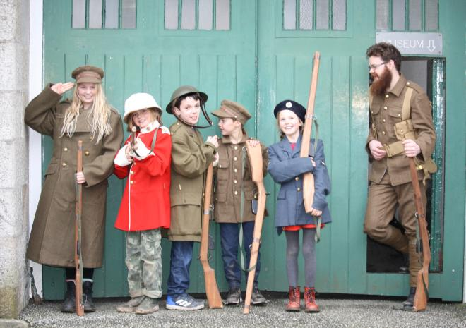 Dressing up in uniforms outside the gates of Bodin Keep