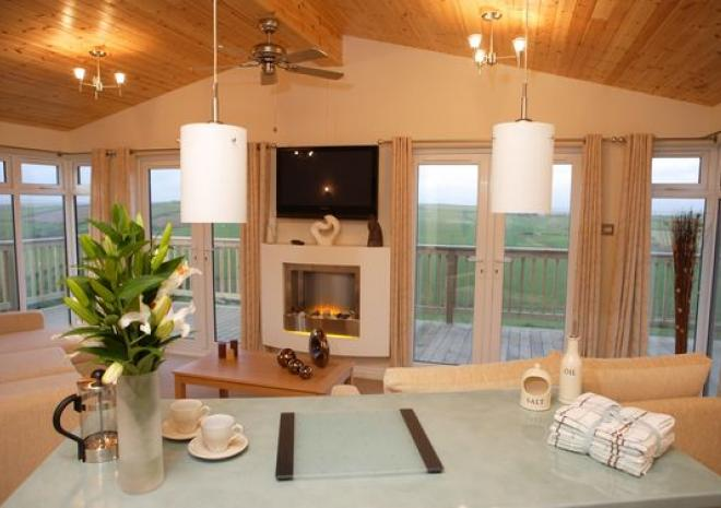 Lodge lounge with patio doors to decking