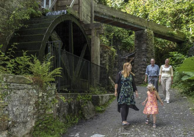 Family walking at Cotehele Mill, Cornwall
