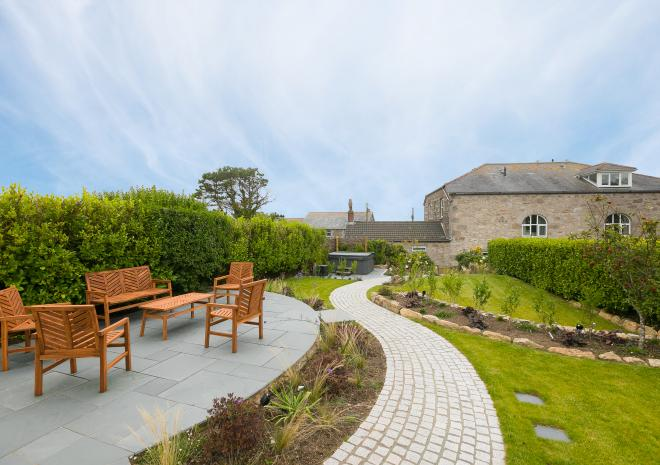 Private landscaped garden with hot tub of holiday cottage, Morwenna, at Polmanter Touring Park, St Ives