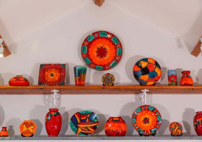 We love our art at Polrunny Farm - a collection of brightly coloured Poole pottery in one of our cottages