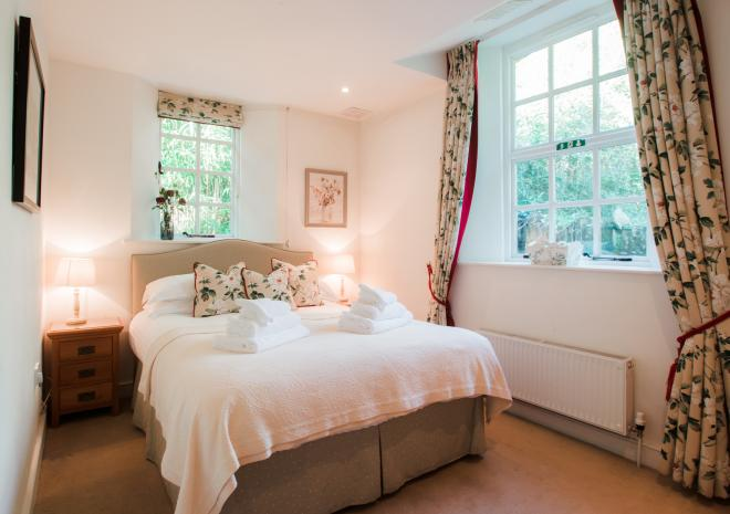 Engine House main double bedroom at Caerhays