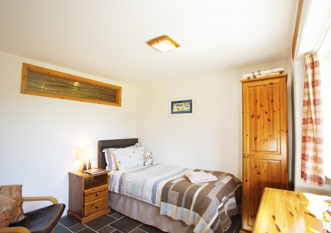 """Bedroom 3 with a 3' single bed. An extra 2'6"""" bed or a wooden cot can be added to this room."""