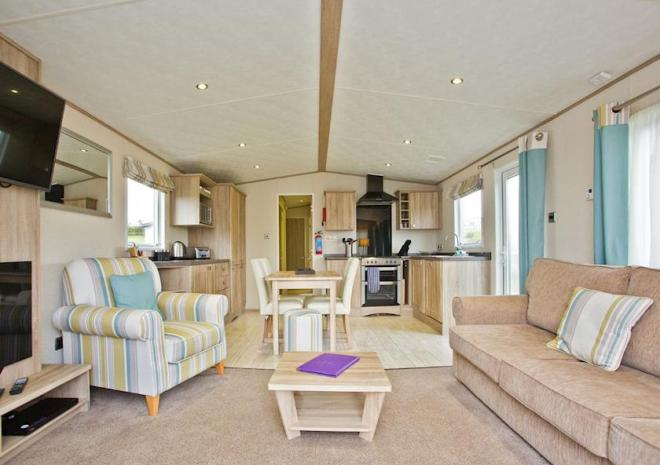 open-plan caravan living area with armchairs and coffee table