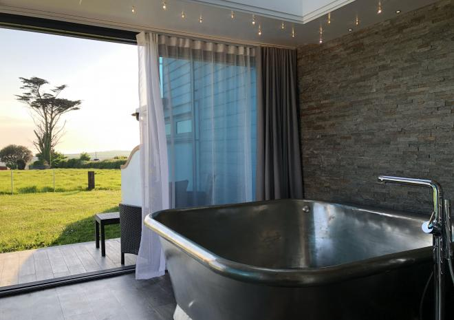 Sun Seeker's freestanding air-spa bath tub with artisan tin finish at Wooldown Holiday Cottages