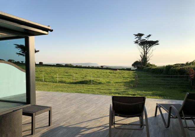 Watch the sunset on the deck of Sundancer at Wooldown Holiday Cottages, Bude