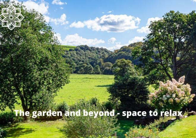 The garden with provides plenty of space to relax and long views