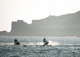 Jetskis approching bottlenose dolphin near Falmouth by St Mawes Photography