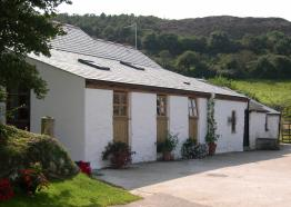 Old Basset Cottage offers lovely self-catering holiday accommodation near Porthtowan in North Cornwall - Front of building
