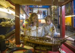 Children exploring the cabinet of curiosities at Charlestown's Shipwreck Museum