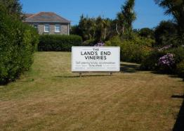 The Vineries sign on the main lawn near the road.